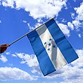 Hand Holding Flag of Honduras.jpg