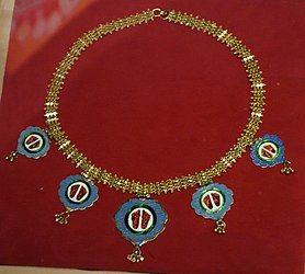 Hindu necklace with kavach depicting Krishna's footprints, worn by pilgrim to Shrinathji temple, Narthdwara, Jaipur or Nathdware, India, 19th century, gold enamel - Bata Shoe Museum - DSC00163.JPG
