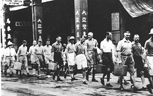 Japanese occupation of Hong Kong - Imperial Japanese soldiers arrested the western bankers and kept them in a Chinese hotel.