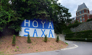 "Hoya Saxa - The phrase ""Hoya Saxa"" is painted in large blue and gray letters at Georgetown's Canal Road entrance"