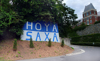 """Hoya Saxa - The phrase """"Hoya Saxa"""" is painted in large blue and gray letters at Georgetown's Canal Road entrance"""
