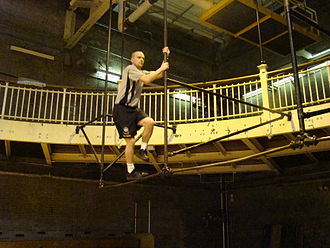Department of Physical Education - Instructor Demonstrates The Elevated Horizontal Bars