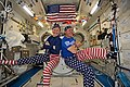 ISS-52 Peggy Whitson and Jack Fischer celebrate the 4th of July in the Kibo lab.jpg