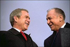 English: George W. Bush and the President of R...