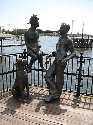 English: Immigrant Statues, Cardiff Bay A bron...