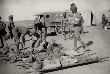 Indian medical orderlies attending to wounded soldiers with the Mesopotamian Expeditionary Force in Mesopotamia during World War I.