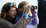 Isobel Ewing, wife of former Ministry of Defence Police Sgt. Jimmy Ewing, helps her daughter adjust a pair of binoculars during a tour of the air traffic control tower at Royal Air Force Mildenhall, United 120810-F-UA873-129.jpg