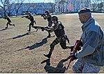 JASDF BDDTS airmen running charge.jpg