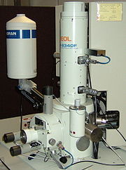 Scanning electron microscope, the column, specimen chamber, and signal detectors