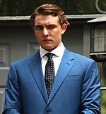 Jacob Wohl wearing a blue suit and black patterned tie