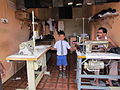 Jaffna tailor proud of his schoolboy son.jpg