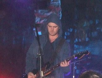 Brand New (band) - Jesse Lacey performing at the Starland Ballroom in June 2006.
