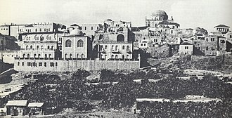 Porat Yosef Yeshiva - The pre-1948 facade of the Porat Yosef Yeshiva (left) facing the Temple Mount. The domed Tiferet Yisrael Synagogue is to the right, rear.