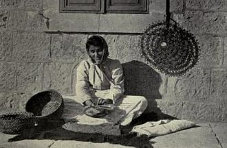 Jifna - A woman in Jifna weaving in the traditional method, 1921