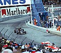 Jochen Mass - McLaren M23 leads Mario Andretti - Lotus 78 out of Tabac at the 1977 Monaco GP.jpg