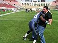 Joe Floccari at LA Coliseum tackled by Marcus Trufant.jpg