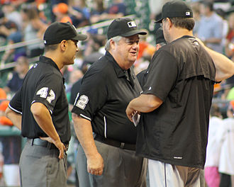 Joe West (umpire) - West (center) before a May 2015 game