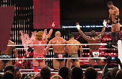 Justin Gabriel performing a 450 splash on Ricky Steamboat.jpg