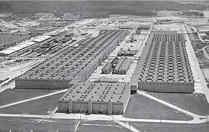 """K-25 - The K-25 building of the Oak Ridge Gaseous Diffusion Plant aerial view, looking southeast.  The mile-long  building, in the shape of a """"U"""" was completely demolished in 2013."""