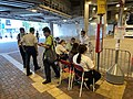 KMB staff in Tuen Mun Station help passengers to take Route 56S 10-10-2020(2).jpg