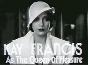 a comely brunette in a white hat and jacket is captioned as the queen of pleasure for the film The House on 56th Street.