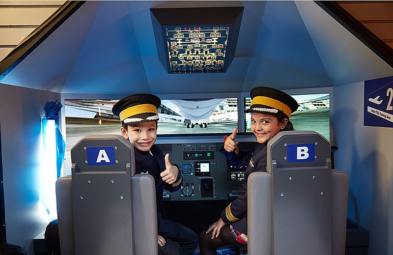 File:KidZania pilots thumbs up while playing in a cockpit simulator.jpg