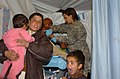 Kids wait out mom's phlebotomy, in Afghanistan.jpg