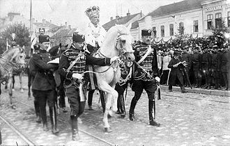 Peter I of Serbia - Peter emerging from St. Michael's Cathedral on horseback following his coronation