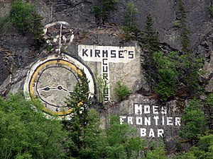 Skagway, Alaska - Gold Rush-era advertisements made on one of the mountains forming the eastern wall of the valley
