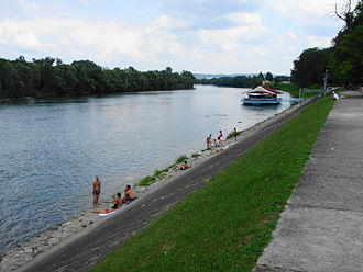 Dubica, Bosnia-Herzegovina - Una river with beach and barboat St. Nikola in background.