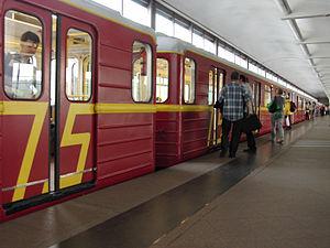 Krasnaya strela (Red arrow) train at Vorobyovy Gory station (Метропоезд Красная стрела на станции Воробьёвы Горы) (4611522179).jpg