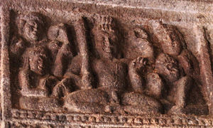 Lakulisha - Lakulisha among his four disciples Kusika, Garga, Mitra, and Kaurushya, rock-cut stone relief, Cave Temple No. 2 at Badami, Karnataka, Early Chalukya dynasty, second half of the 6th century CE