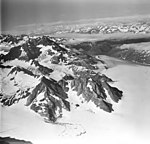 Lamplugh Glacier, tidewater glacier looking down glacier from icefield and icefall on the mountainside, August 23, 1976 (GLACIERS 5586).jpg