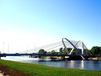 Malaya Nevka River - Malaya Nevka. View at the Lazarevsky Bridge and Krestovsky Island.