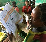 Learning to read, Ethiopia (25856182798).jpg