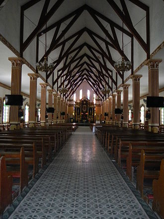 Bay (architecture) - Looking down the center aisle of the Saint Roch Parish Church of Lemery, Batangas, Philippines, the spaces between each set of columns and roof trusses are a bay