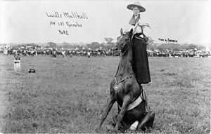Lucille Mulhall - Lucille Mulhall, standing on the back of a seated horse