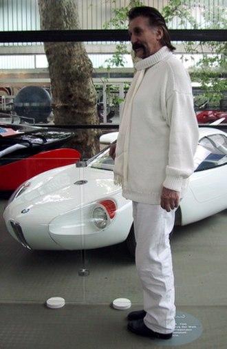 """Luigi Colani - Luigi Colani in front of his BMW 700 in the exhibition """"COLANI – Das Lebenswerk"""" (Karlsruhe) in 2004."""