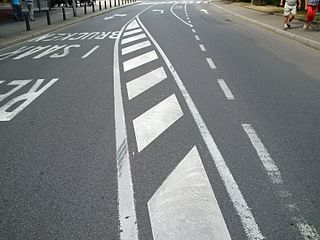 Road surface marking Any kind of device or material used on a road surface to convey official information