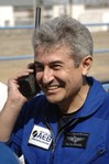 M. Pontes using a satellite phone.tif