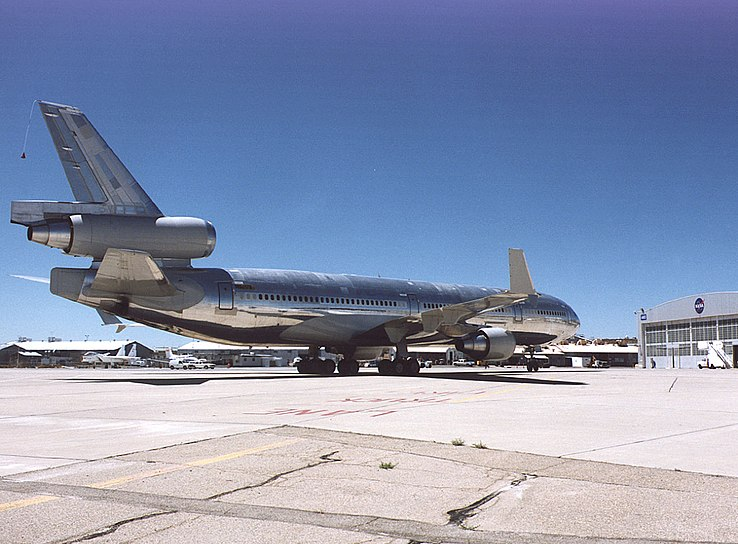 File:MD-11 in front of hangars.jpg