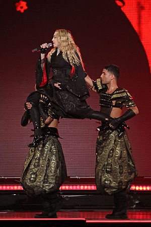 "Bitch I'm Madonna - Madonna being carried by her dancers while performing ""Bitch I'm Madonna"" on the Rebel Heart Tour."