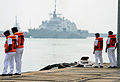 Malaysian sailors watch as the littoral combat ship USS Freedom (LCS 1) arrives for Cooperation Afloat Readiness and Training (CARAT) 2013 in Kuantan, Malaysia, June 15, 2013 130615-N-YU572-014.jpg