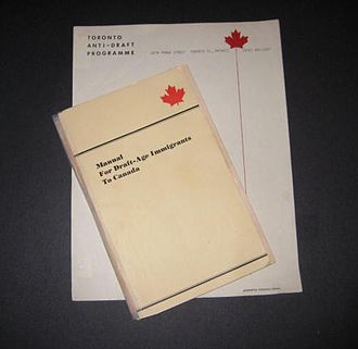 Draft evasion - Tattered copy of the Manual for Draft-Age Immigrants to Canada (1968) atop Anti-Draft Programme stationery.
