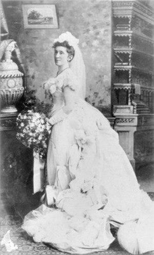 Margaret Forrest - Margaret Forrest wearing a court dress, 1876