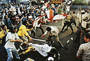 Trisakti University - Trisakti University students clash with police forces during the Indonesian riots of May 1998.