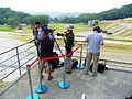 Media Photographers Talking and Adjusting Cameras on Grand Stand 20121013a.jpg