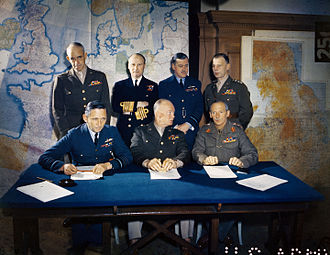 Normandy landings - Meeting of the Supreme Headquarters Allied Expeditionary Force (SHAEF), 1 February 1944. Front row: Air Chief Marshal Arthur Tedder; General Dwight D. Eisenhower; General Bernard Montgomery. Back row: Lieutenant General Omar Bradley; Admiral Bertram Ramsay; Air Chief Marshal Trafford Leigh-Mallory; Lieutenant General Walter Bedell Smith.
