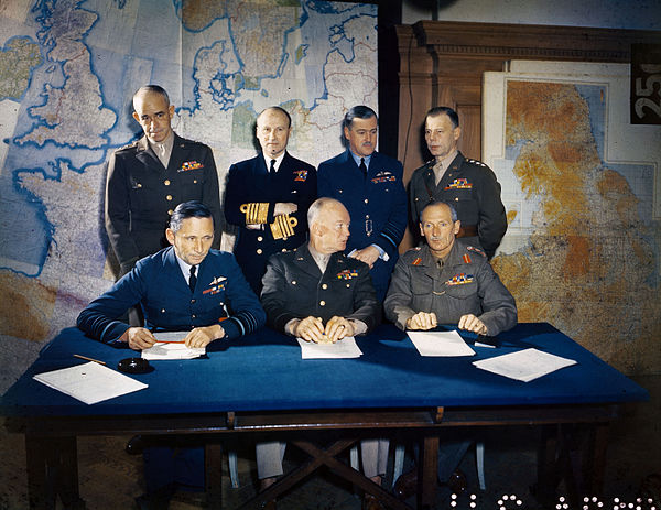 Meeting of the Supreme Headquarters Allied Expeditionary Force (SHAEF), 1 February 1944. Front row: Air Chief Marshal Arthur Tedder; General Dwight D. Eisenhower; General Bernard Montgomery. Back row: Lieutenant General Omar Bradley; Admiral Bertram Ramsay; Air Chief Marshal Trafford Leigh-Mallory; Lieutenant General Walter Bedell Smith. Meeting of the Supreme Command, Allied Expeditionary Force, London, 1 February 1944 TR1631.jpg