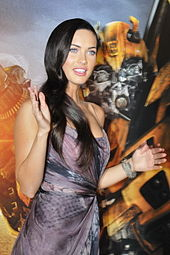 Megan Fox, standing in front of one the only reasons she became famous.